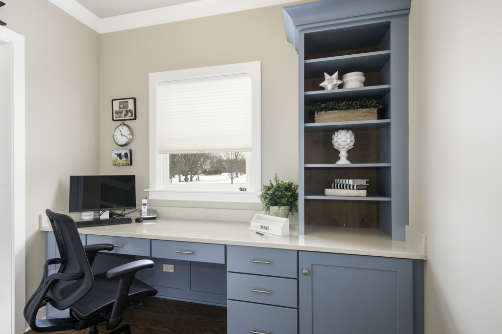 built in desk with blue cabinetry