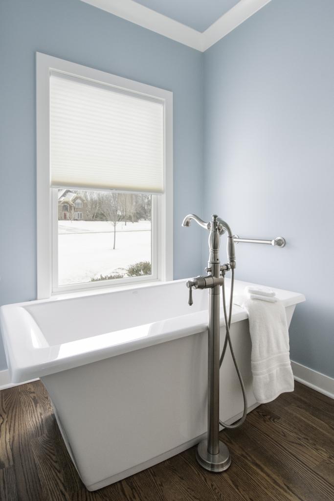 White Soaking Tub in blue bathroom