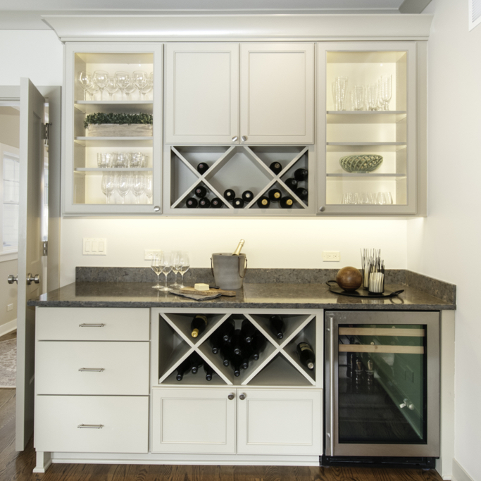 libations counter with cabinets, wine storage, and refrigeration
