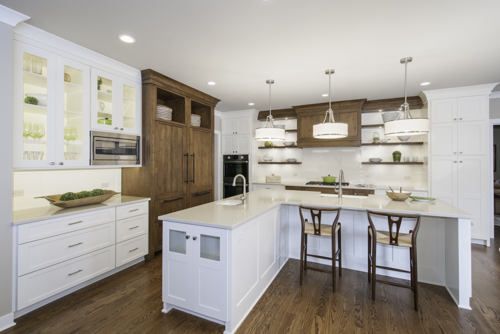 Kitchen remodeled using white and wood cabinets