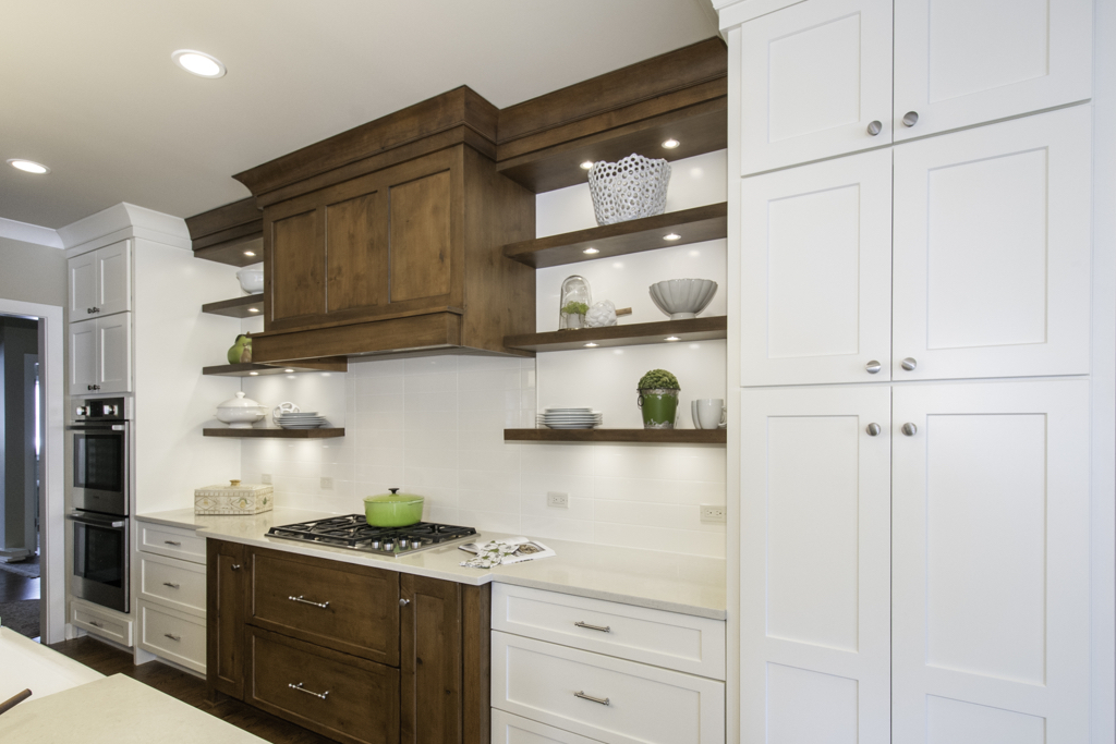 Renovated kitchen with white and wood cabinetry