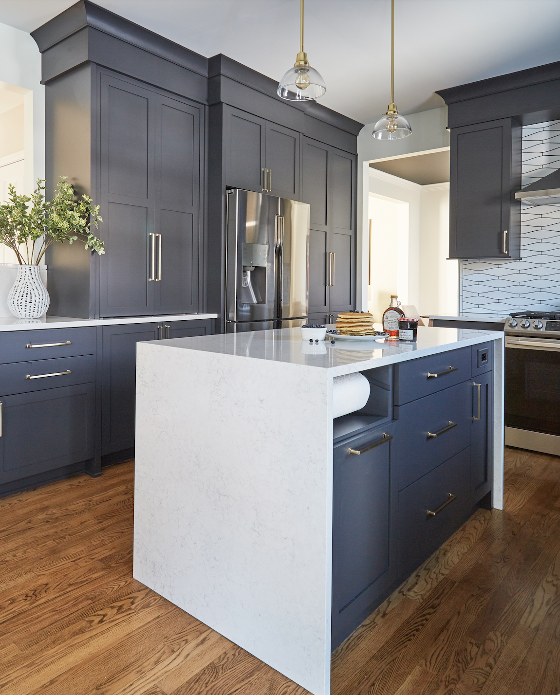 Waterfall Countertop by Kane Home Cabinetry
